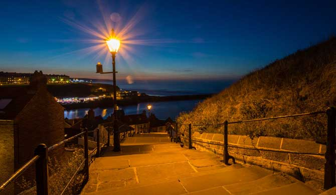 The famous 199 steps at Whitby seen by night.